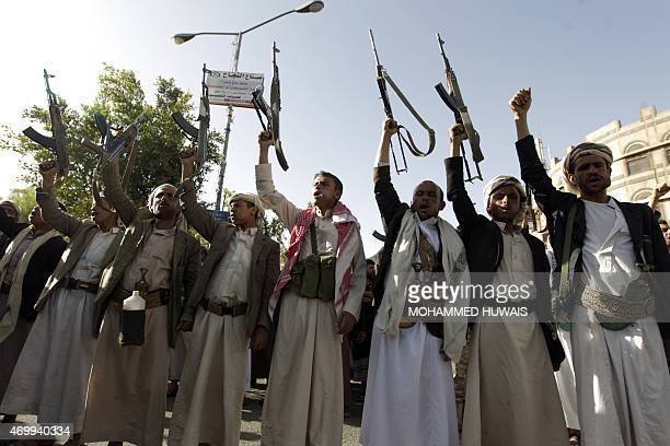 Tribal gunmen loyal to the Shiite Huthi movement raise their weapons on April 16 2015 in the capital Sanaa during a demonstration against the...