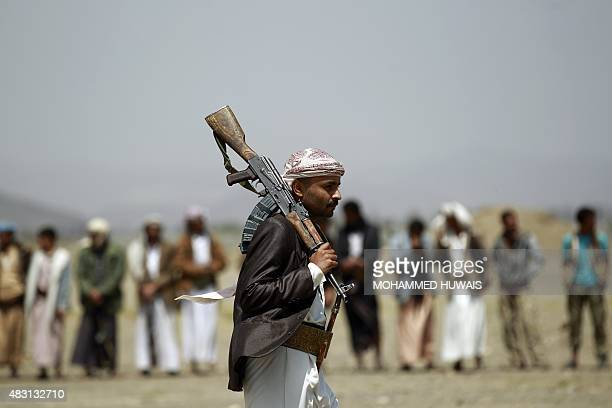 Tribal gunmen loyal to the ShiiteHuthi movement gather for a demonstration against the Saudiled intervention in the country in the Bani alHarith area...