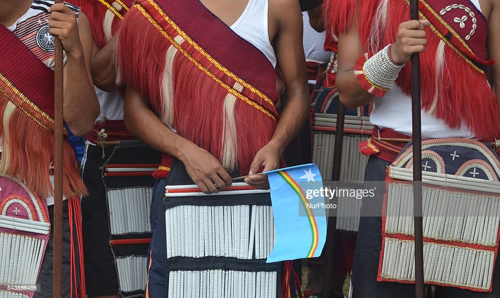 Tribal Naga men in traditional attires hold a Naga flag waits for the arrival of the mortal remain of late Isak Chishi Swu for public funeral service in honour of Isak Chishi Swu, Chairman of the NSCN-IM at Dimapur, India north eastern state of Nagaland on Thursday, June 30, 2016. Thousands of mourners pay tribute to late Isak Chishi Swu chairman of the NSCN-IM who dies at a private hospital in Delhi on June 28.