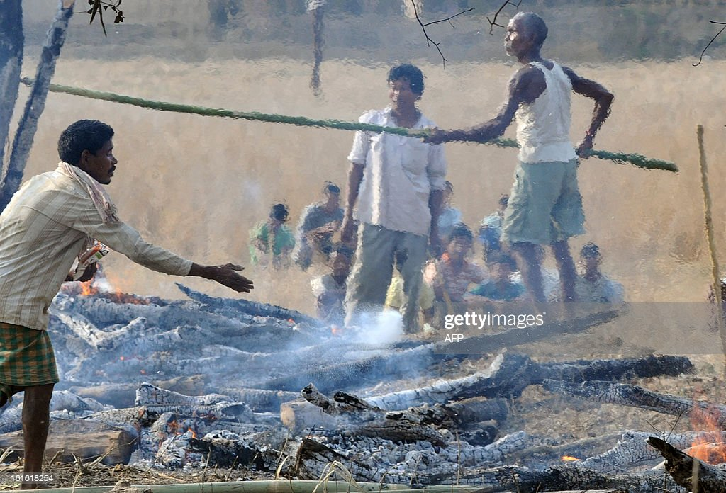Tribal villagers cremate the remains of those allegedly shot by police during electoral violence in Darrangi Kasadol village in Goalpara, some 135 km from Guwahati in India's northeastern state of Assam, on February 13, 2013. India deployed hundreds of troops and imposed a curfew on Wednesday as the death toll from electoral violence in the northeastern state of Assam climbed to 20.