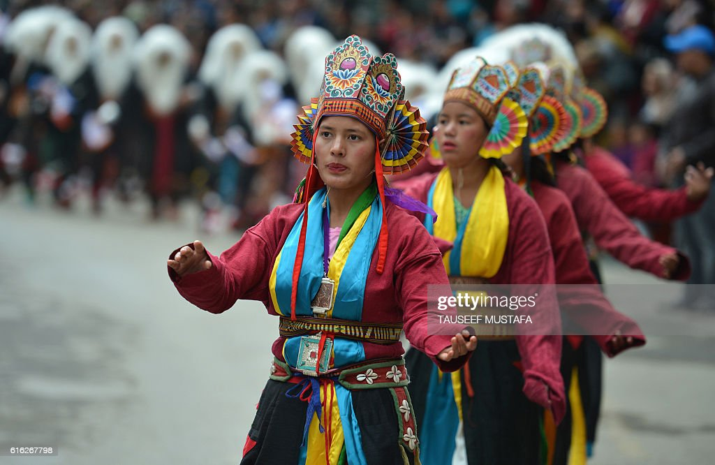 Tribal women dance during the second day of the three-day Tawang festival in Tawang, near the Indo-China border in north eastern Arunachal Pradesh state on October 22, 2016 The Tawang Festival 2016 runs from October 21 with a three-day programme to promote tourism and showcase the culture and traditions of the district in particular, and the state in general. / AFP / TAUSEEF