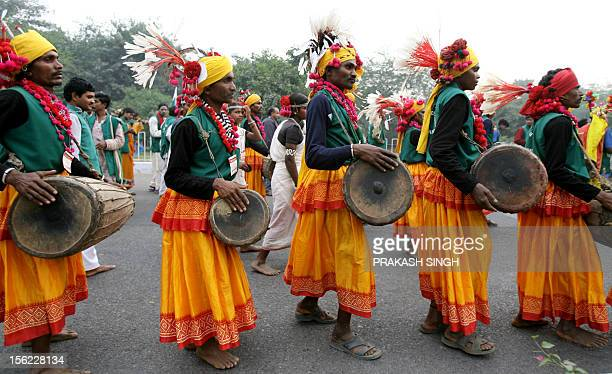 Tribals from the Indian state of Chattisgarh perform during a peace march at the India Social Forum in New Delhi 12 November 2006 The ISF is...