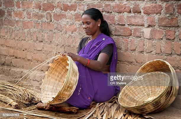 Tribe women making basket