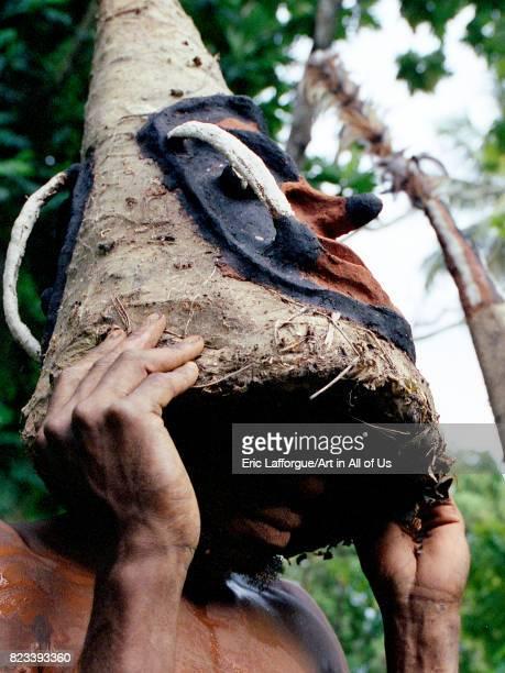 Tribesmen dancing in the jungle with helmet masks for a circumcision ceremony Malampa Province Malekula island Vanuatu on August 22 2007 in Malekula...