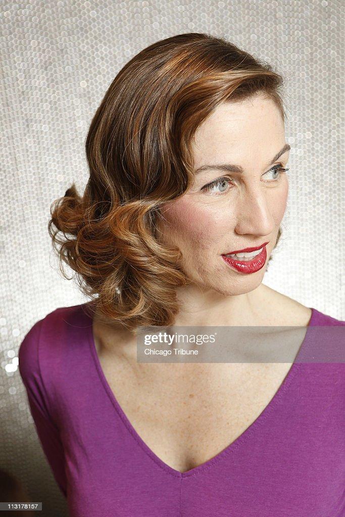 Tribune reporter <b>Heidi Stevens</b> shows off an elegant, dressy hair style, ... - tribune-reporter-heidi-stevens-shows-off-an-elegant-dressy-hair-style-picture-id113178157