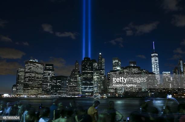 Tribute in Light illuminate the New York City sky between the Twin Towers of the World Trade Center in New York to mark the 14th anniversary of the...