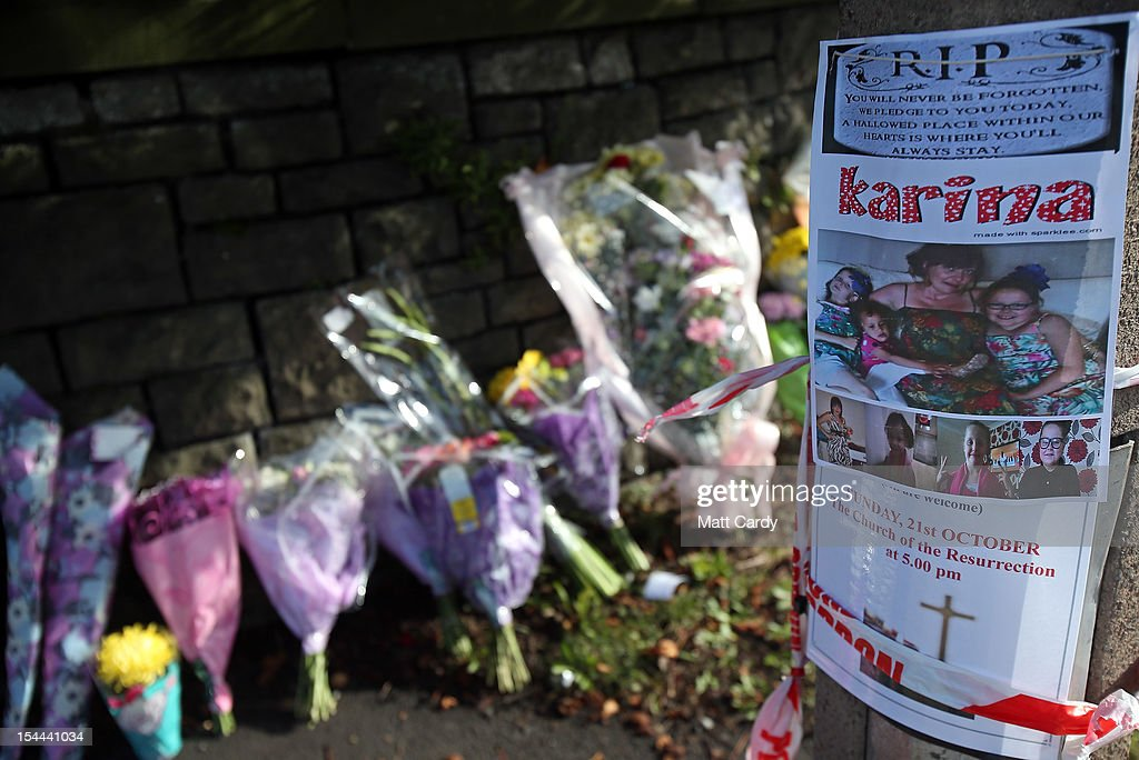 A tribute poster is seen beside the growing number of floral tributes being left outside Ely Fire Station where a 32-year-old woman, named locally as Karina Menzies, was killed in a hit-and-run collision yesterday on October 20, 2012 in Cardiff, Wales. Detectives are questioning a 31-year-old man arrested on suspicion of murder after a series of hit-and-runs in Cardiff that left a woman dead and 13 people injured. Nine casualties, five of them children, are still in hospital. Two adults are in critical but stable conditions.