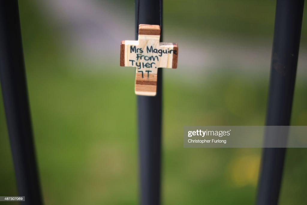 A tribute to murdered teacher Anne Maguire in the form of a wooden cross adorns the school fence at Corpus Christi Catholic College in Neville Road on April 29, 2014 in Leeds, England. A fifteen year old male student has been arrested in connection with the death of teacher Anne Maguire, who was fatally stabbed yesterday during a lesson at Corpus Christi Catholic Catholic College.