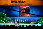 A tribute to Nelson Mandela is displayed on a screen as FIFA President Joseph S Blatter Brazil President Dilma Rousseff and hosts Fernanda Lima and...