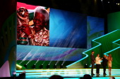 A tribute to Nelson Mandela is displayed on a screen on stage as FIFA President Joseph S Blatter Brazil President Dilma Rousseff and hosts Fernanda...