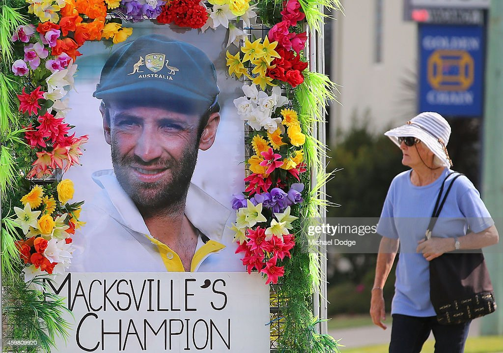 A tribute to Phillip Hughes is displayed outside a car dealership on December 2, 2014 in Macksville, Australia. Cricket player, Phillip Hughes passed away aged 25, as a result of head injuries sustained during the Sheffield Shield match between South Australia and New South Wales at the SCG on 25th November. The funeral for Hughes will be held in his hometown of Macksville tomorrow.