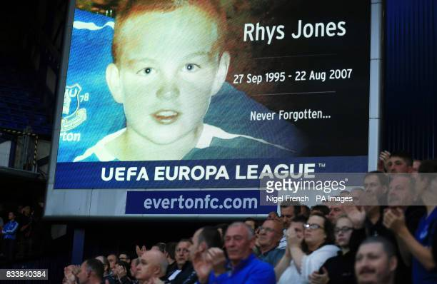 A tribute to Rhys Jones is shown on the big screen during the UEFA Europa League PlayOff First Leg match at Goodison Park Liverpool