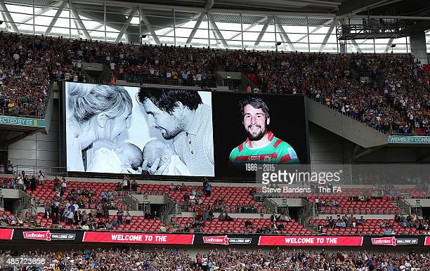 A tribute to Rugby League player Danny Jones appears on the giant screen prior to the Ladbrokes Challenge Cup Final at Wembley Stadium on August 29...