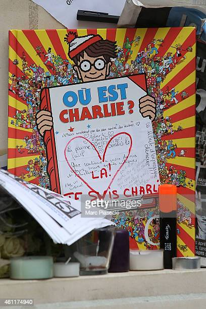 A tribute to victims is pictured close to the 'Charlie Hebdo' offices on a day of mourning following a terrorist attack in the satirical newspaper...