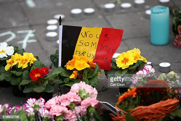 Tributes are left at the Place de la Bourse following today's attacks on March 22 2016 in Brussels Belgium At least 31 people are thought to have...