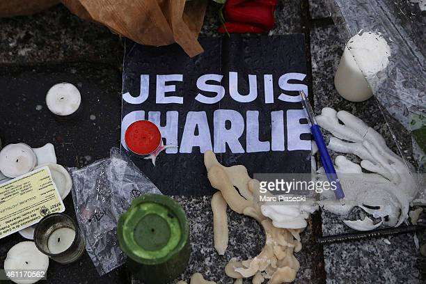 Tributes are left close to the Charlie Hebdo offices on a day of mourning following a terrorist attack on the satirical newspaper building on January...