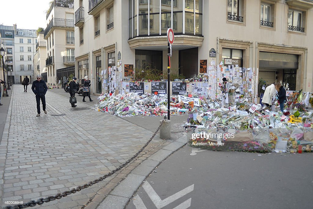 Charlie Hebdo magazine attack: vigils held as French hunt suspects – as it happened