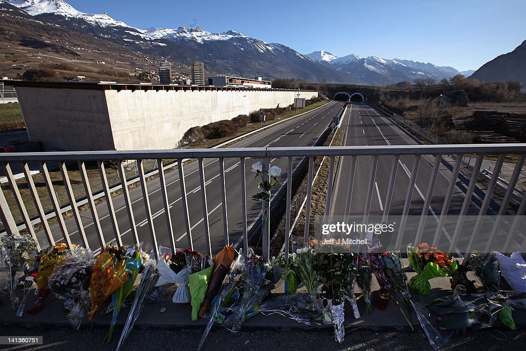 Tributes are left on a bridge near to the entrance of the motorway tunnel in which 22 school children and 6 adults died in a bus crash two days ago, March 15, 2012 in Sierre, Switzerland. The accident occurred when a school bus carrying 11 -12 year old children back to Belgium from a skiing holiday, crashed into a tunnel wall, killing 28 of the 52 passengers. Belgian authorities will fly the bodies of the victims home shortly.