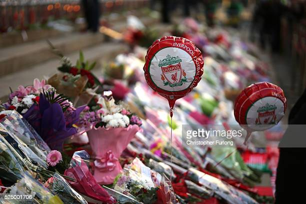 Tributes are left outside Liverpool's Saint George's Hall as thousands of people gather to attend a vigil for the 96 victims of the Hillsborough...