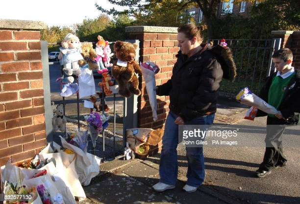 Tributes are left outside Redhill Infants School in Castleford West Yorkshire where Shannon Louise Hennessey was a pupil