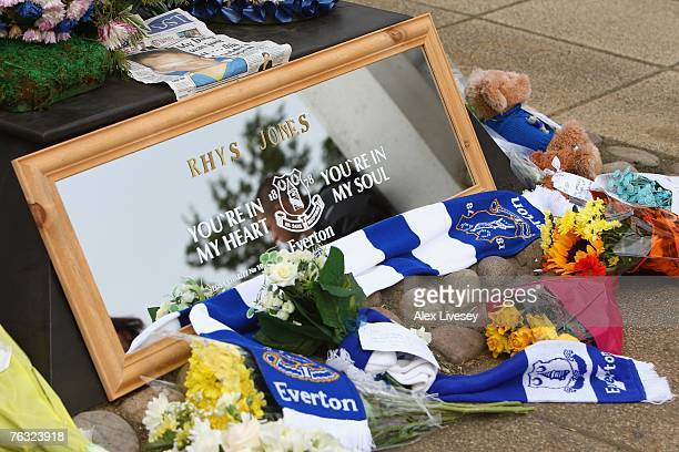 Tributes are left outside the ground to the murdered young Everton fan Rhys Jones prior to the start of the Barclays Premier League match between...
