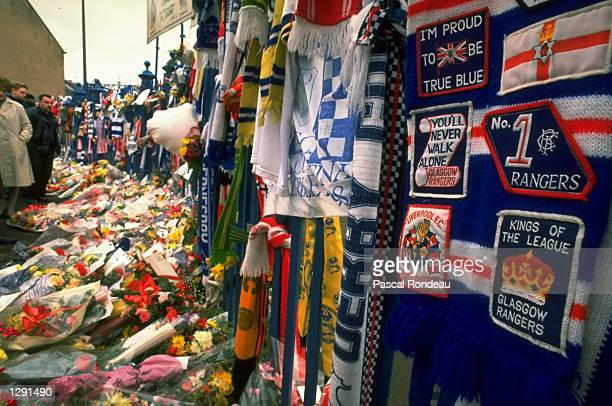 Tributes cover a fence and path in the aftermath of the disaster at Hillsborough in Sheffield England Mandatory Credit Pascal Rondeau/Allsport