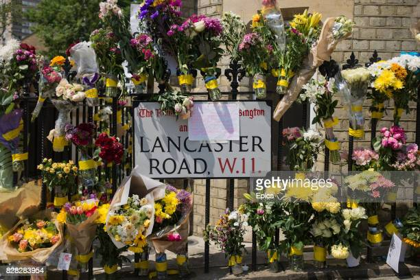 Tributes flowers and condolences close by to Grenfell tower a residential tower block North Kensington which was engulfed in flames in the early...