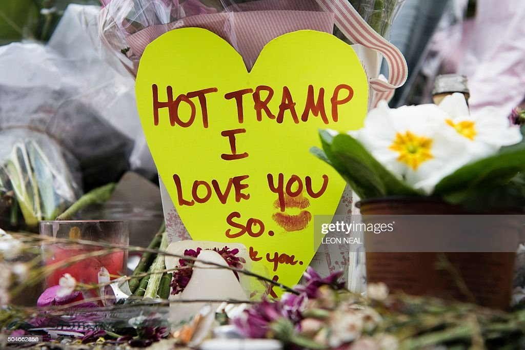 Tributes laid in homage to British singer <a gi-track='captionPersonalityLinkClicked' href=/galleries/search?phrase=David+Bowie&family=editorial&specificpeople=171314 ng-click='$event.stopPropagation()'>David Bowie</a>, are seen beneath a mural of the music legend, in Brixton, south London, on January 12, 2016, a day after the announcement of Bowie's death. Music legend <a gi-track='captionPersonalityLinkClicked' href=/galleries/search?phrase=David+Bowie&family=editorial&specificpeople=171314 ng-click='$event.stopPropagation()'>David Bowie</a> was famously private during his lifetime -- and in death, as a string of questions about the circumstances of his passing remained unanswered. His official social media accounts had announced the shock news of his death at 69 on January 11, 2016: '<a gi-track='captionPersonalityLinkClicked' href=/galleries/search?phrase=David+Bowie&family=editorial&specificpeople=171314 ng-click='$event.stopPropagation()'>David Bowie</a> died peacefully today surrounded by his family after a courageous 18-month battle with cancer,' adding a request for privacy for the grieving family.