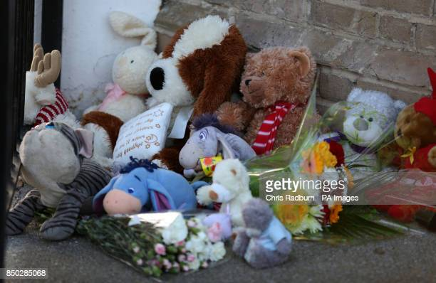 Tributes lay outside a flat in London Road South Lowestoft following the discovery of three children's bodies at the property