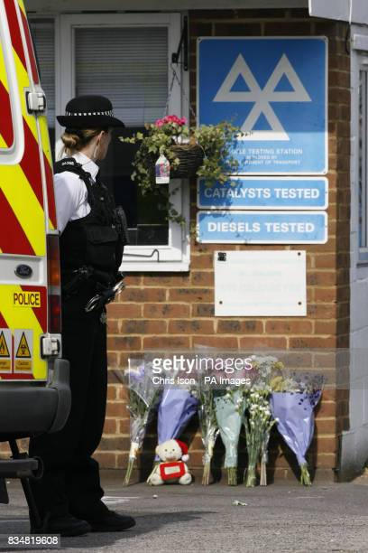 Tributes left at Paynes Road Car Sales garage in Southampton where a man named locally as David Cass is believed to have killed his two young...