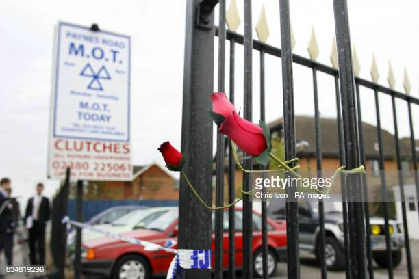 Tributes left at the Paynes Road Car Sales garage in Southampton where a man named locally as David Cass is believed to have killed his two young...