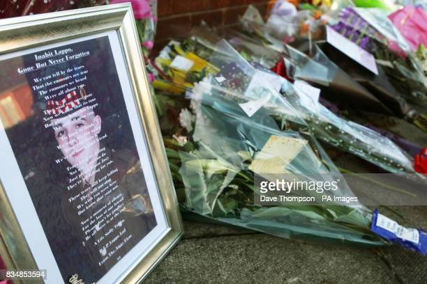 Tributes left at the scene where Joseph Lappin was stabbed to death outside a youth club in Everton on Monday night