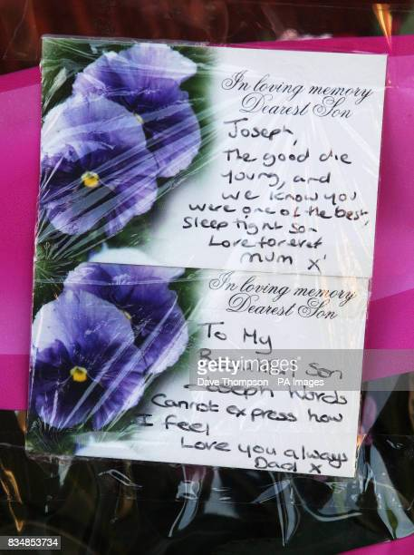Tributes left by John and Toni Lappin with flowers at the scene where their son Joseph Lappin was stabbed to death outside a youth club in Everton on...