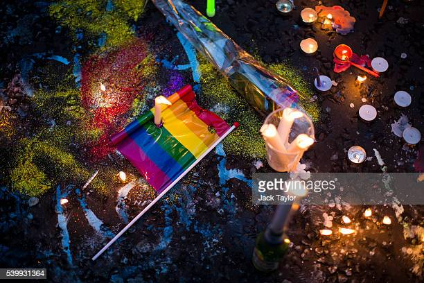 Tributes left during a vigil for the victims of the Orlando nightclub shooting on Old Compton Street Soho on June 13 2016 in London England 49 people...