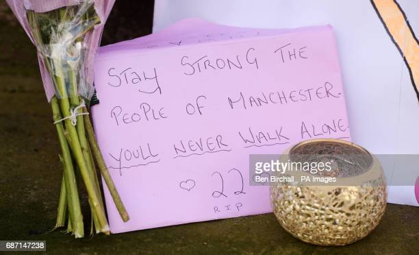 Tributes left outside St Ann's Church in Manchester the morning after a suicide bomber killed 22 people including children as an explosion tore...