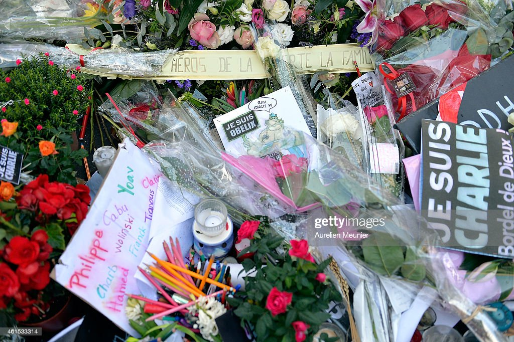 Tributes of drawings flowers pens and candles are left in front of the Charlie Hebdo offices on January 14 2015 in Paris France Released today an...