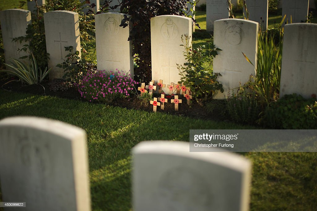 Tributes surround the gravestone of John Condon at the Poelcapelle British Cemetery John Condon of Waterford Ireland is believed to have been the...