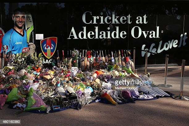 Tributes to the late Phillip Hughes are seen during day one of the First Test match between Australia and India at Adelaide Oval on December 9 2014...