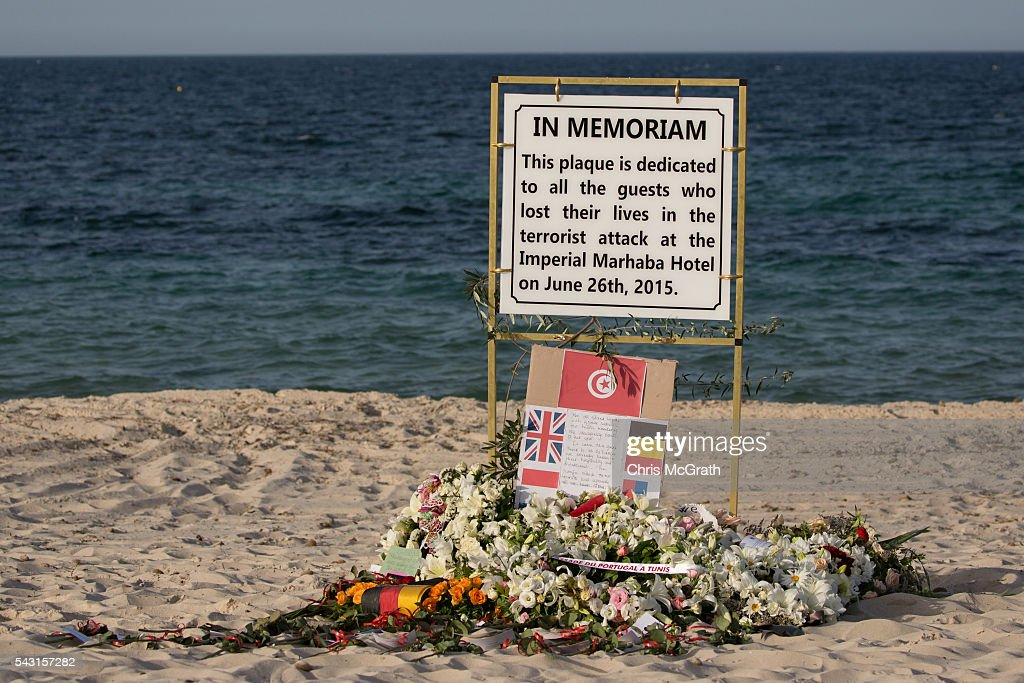 Tributes to the victims of the 2015 Sousse Beach terrorist attack are seen on the beach after a memorial service in front of the Imperial Marhaba hotel on June 26, 2016 in Sousse, Tunisia. Today marks the one year anniversary of the Sousse Beach terrorist attack, which killed 38 people including 30 Britons. Before the 2011 revolution, tourism in Tunisia accounted for approximately 7% of the countries GDP. The two 2015 terrorist attacks at the Bardo Museum and Sousse Beach saw tourism numbers plummet even further forcing hotels to close and many tourism and hospitality workers to lose their jobs.