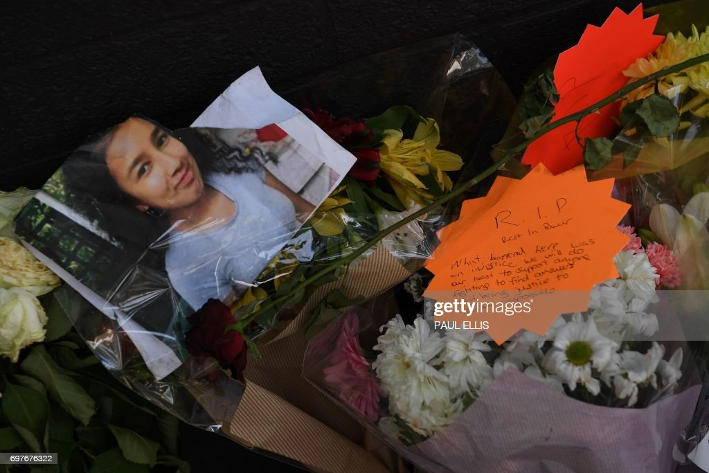 Tributes to the victims of the Grenfell Tower fire, a residential tower block in Kensington, west London, are pictured on June 19, following the June 14 fire which gutted the residential building. Seventy-nine people are dead or missing and presumed dead following a devastating blaze in a London tower block, police said Monday, as Britain held a minute's silence for the victims. / AFP PHOTO / Paul ELLIS