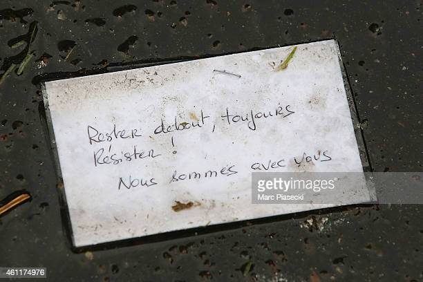 Tributes to victims are left outside the Charlie Hebdo offices on a day of mourning following a terrorist attack at the satirical newspaper building...