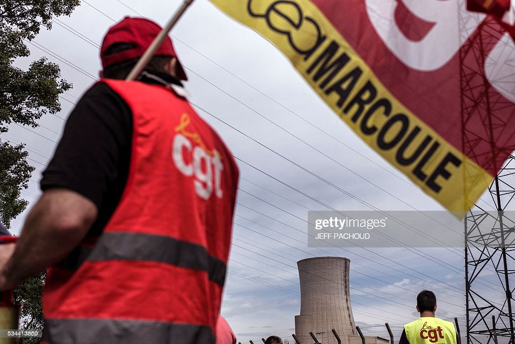 Tricastin Nuclear site's employees protest on May 26, 2016 at the Saint-Paul-Trois-Chateaux, nuclear site's entrances, during a protest against controversial labour market reforms that has already severely disrupted fuel supplies. With two weeks until France hosts the Euro 2016 football championships, the country has been paralysed by a series of transport strikes and fuel shortages that has heaped pressure on the deeply unpopular Socialist government. AFP PHOTO / JEFF PACHOUD With two weeks until France hosts the Euro 2016 football championships, the country has been paralysed by a series of transport strikes and fuel shortages that has heaped pressure on the deeply unpopular Socialist government. / AFP / JEFF
