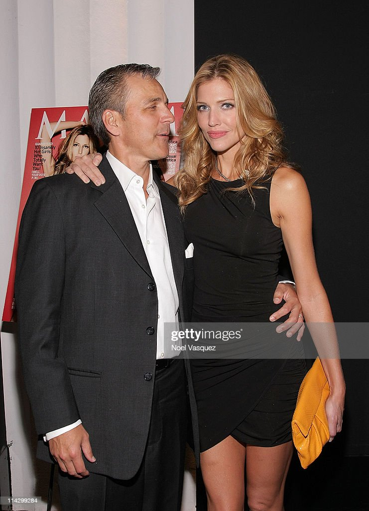 <a gi-track='captionPersonalityLinkClicked' href=/galleries/search?phrase=Tricia+Helfer&family=editorial&specificpeople=227945 ng-click='$event.stopPropagation()'>Tricia Helfer</a> (R) and her husband Jonathan Marshall (L) attend her Maxim Cover Party hosted by SBE at Mi-6 Night club on October 20, 2009 in West Hollywood, California.
