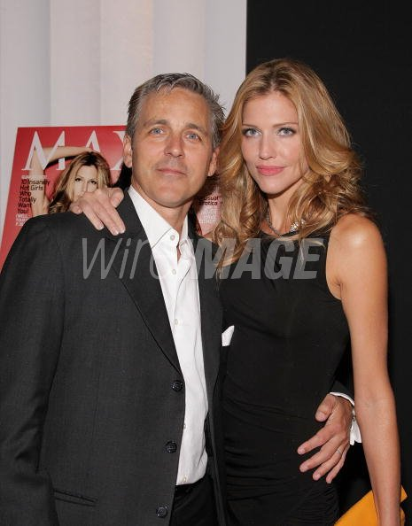 Tricia Helfer and her husband Jonathan Marshall attend her ...