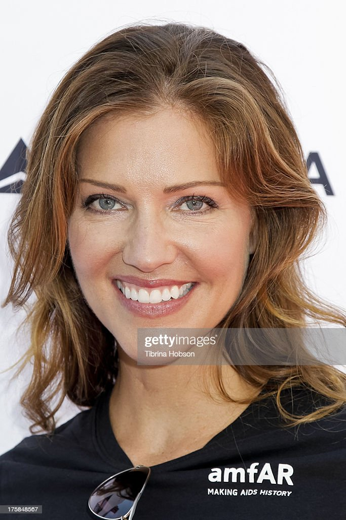 Tricia Helfer attends the 4th annual Kiehl's LifeRide for amfAR at The Grove on August 8, 2013 in Los Angeles, California.