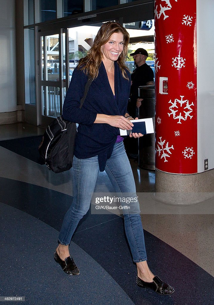 <a gi-track='captionPersonalityLinkClicked' href=/galleries/search?phrase=Tricia+Helfer&family=editorial&specificpeople=227945 ng-click='$event.stopPropagation()'>Tricia Helfer</a> is seen arriving at Los Angeles International airport on December 01, 2013 in Los Angeles, California.