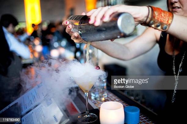 Tricia LaCount bar and floor manager mixes a drink with liquid nitrogen at Blue Inc on Thursday July 14 2011