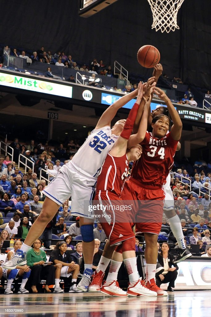 Tricia Liston #32 and Elizabeth Williams #1 of the Duke Blue Devils fight for a rebound against Marissa Kastanek #23 and Markeisha Gatling #34 of the North Carolina State Wolfpack during the quarterfinals of the 2013 Women's ACC Tournament at the Greensboro Coliseum on March 8, 2013 in Greensboro, North Carolina.