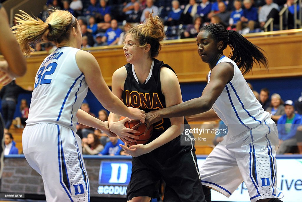 Tricia Liston #32 and Elizabeth Williams #1 of the Duke Blue Devils fight for the ball against Jordan Henry #22 of the Iona Gaels at Cameron Indoor Stadium on November 18, 2012 in Durham, North Carolina.
