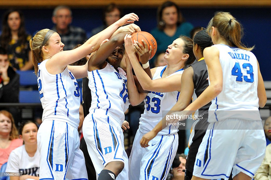 Tricia Liston #32, Chelsea Gray #12 and Haley Peters #33 of the Duke Blue Devils fight for a rebound against the Valparaiso Crusaders at Cameron Indoor Stadium on November 23, 2012 in Durham, North Carolina.